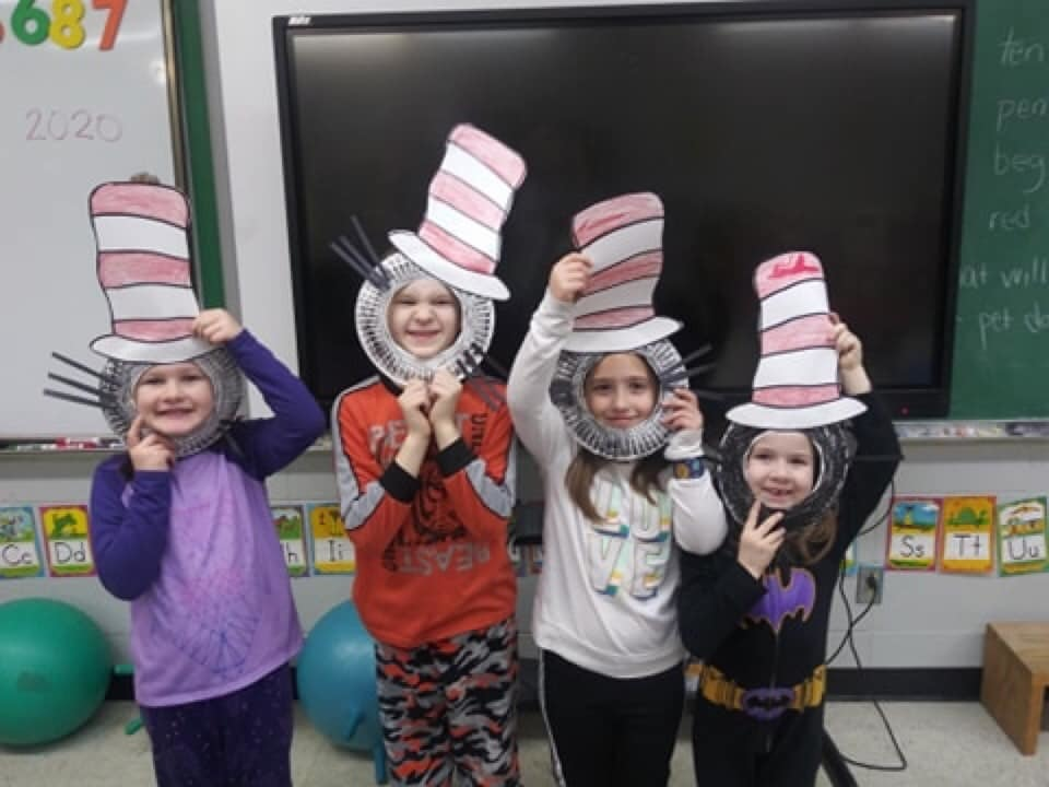 Students with homemade cat in the hat outfits